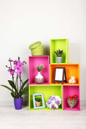 Beautiful colorful shelves with different home related objects photo