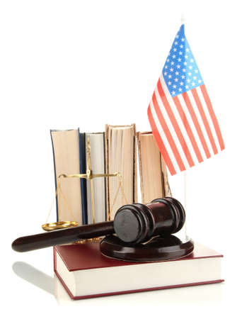 Wooden gavel, golden scales of justice, books and American flag isolated on white photo