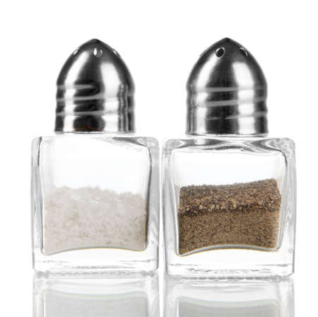 Containers for salt and pepper isolated on white photo
