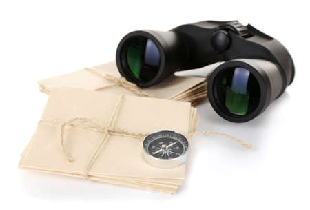 Black modern binoculars with old letters isolated on white photo
