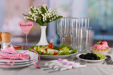 Table setting on room background photo