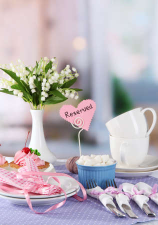 Tableware for tea drinking on bright background photo