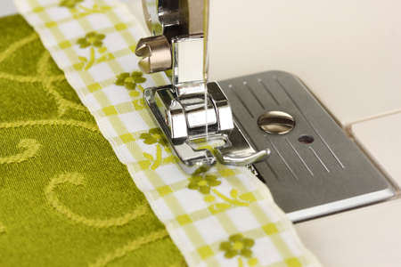 Closeup of sewing machine working part with  green cloth Stock Photo - 19300532