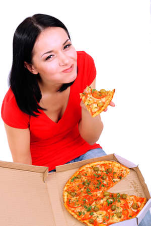 Beautiful girl eats pizza isolated on white photo
