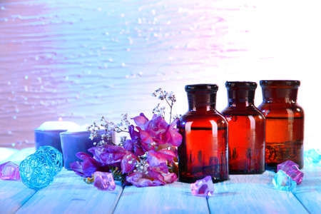 Spa oil and freesia on light background photo