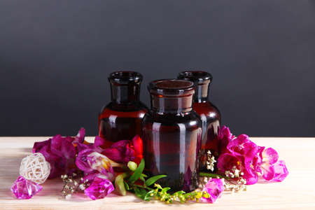 Spa oil and freesia on gray background photo