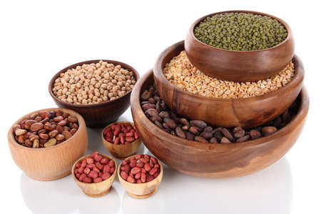 Different kinds of beans in bowls isolated on white photo