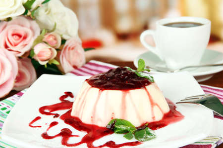 Panna Cotta with raspberry sauce, on bright background photo