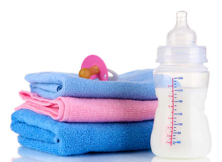Bottle for milk with towels and nipple isolated on white Stock Photo - 19300577