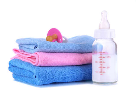 Bottle for milk with towels and nipple isolated on white Stock Photo - 19300613