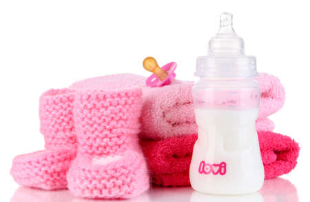 Bottle for milk with towels and nipple isolated on white Stock Photo - 19300578