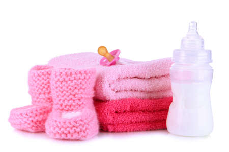 Bottle for milk with towels and nipple isolated on white Stock Photo - 19300591