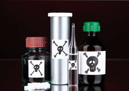 Deadly poison in bottles on black background Stock Photo - 19338069