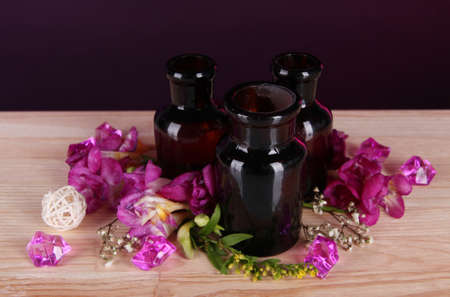 Spa oil and freesia on bright background photo