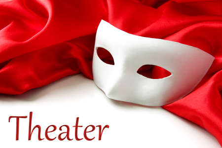 drama: White mask and red silk fabric, isolated on white Stock Photo