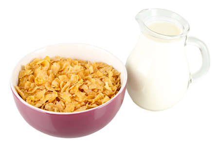 Delicious and healthy cereal in bowl with milk isolated on white photo