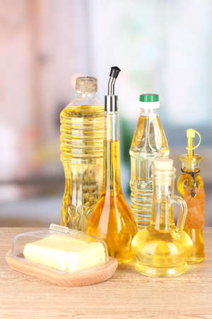 Different types of oil on table in kitchen photo