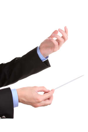 louder: Music conductor hands with baton isolated on white Stock Photo