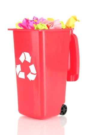 Recycling bin with papers isolated on white photo