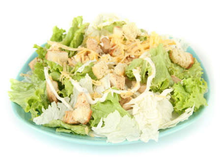 Caesar salad on blue plate, isolated on white photo