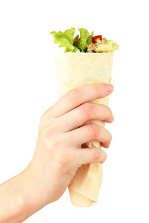 burrito: Hand holding kebab - grilled meat and vegetables, wrapped in pita, isolated on white
