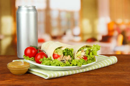 Kebab - grilled meat and vegetables, on plate, on wooden table, on bright background photo
