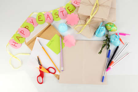odd jobs: Writing letter of congratulations to Easter holidays isolated on white Stock Photo