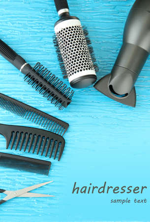 Comb brushes, hairdryer and cutting shears,on color background Stock Photo - 19424573