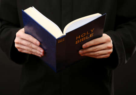 big bible: Priest reading from the holy bible, close up