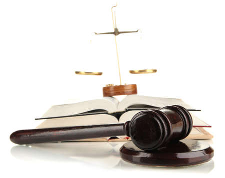 proceeding: Wooden gavel, golden scales of justice  and books isolated on white