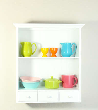 Kitchen utensils on beautiful white shelves photo