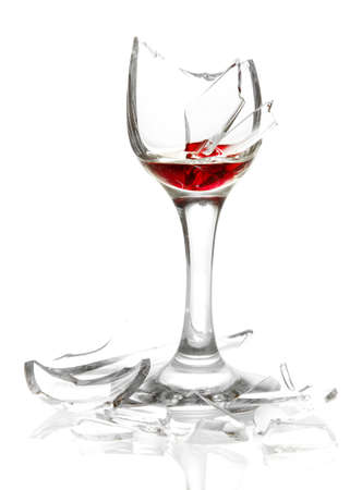 Broken wineglass isolated on white photo