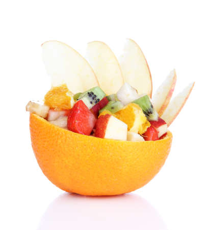 Fruit salad in hollowed-out orange isolated on white photo