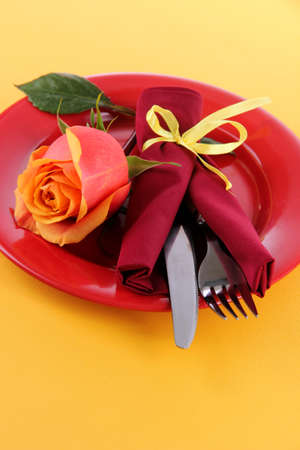 Served plate with napkin and flowers close-up photo