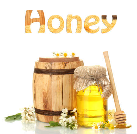 Sweet honey in jar and barrel with acacia flowers isolated on white photo