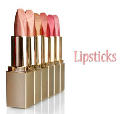 Beautiful lipsticks, isolated on white photo