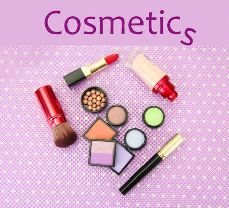Decorative cosmetics on purple background photo