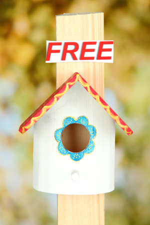 Decorative nesting box and sign on bright background photo