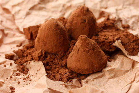 comfit: Chocolate truffles and cocoa, on brown background Stock Photo