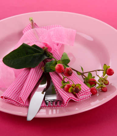 Served plate with napkin and flower close-up photo