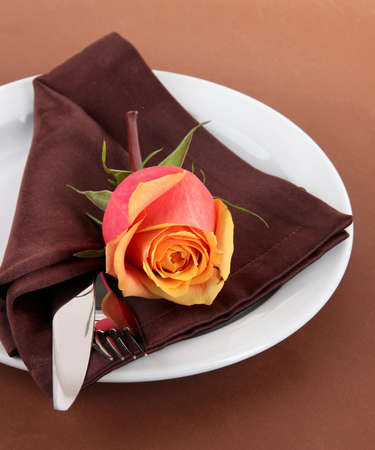 Served plate with napkin and rose close-up photo