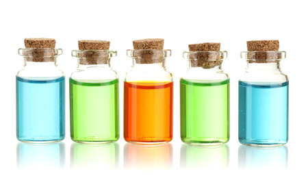 Bottles with basics oils isolated on white Imagens