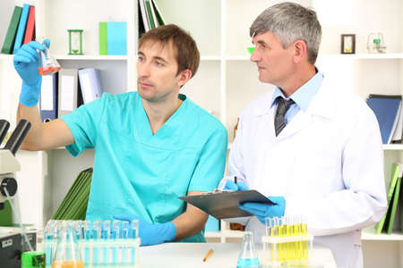 control room: Physician and assayer during research on room background Stock Photo