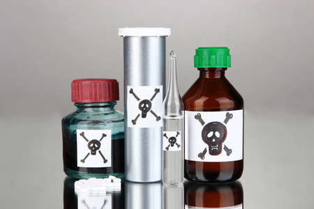 deadly: Deadly poison in bottles on grey background