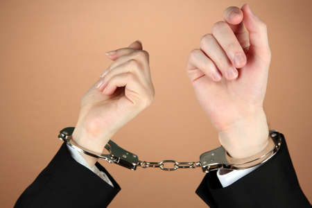Man and woman hands and breaking handcuffs on color background photo
