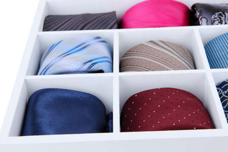 Neckties in wooden box close-up photo