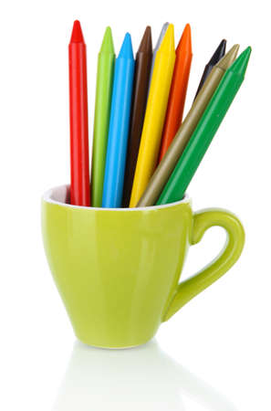 Colorful pencils in cup isolated on white photo