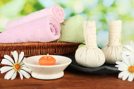 Textile massage spa equipment on nature background photo