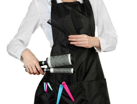 uniform curls: Hairdresser in uniform with working tools, isolated on white