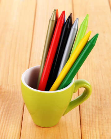 Colorful pencils in cup on table photo